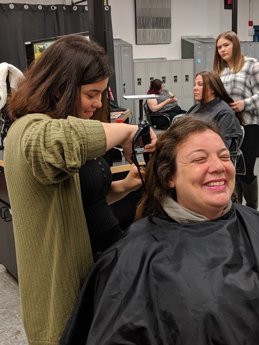 West Sound student provides hair styling to a client